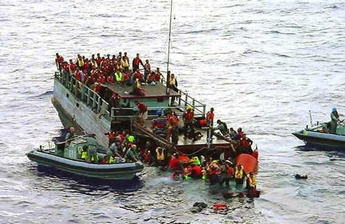 Australian navy rescue asylum-seekers from a sinking boat off Christmas Island in October 2001. The government concoted a story that children were thrown overboard by refugees in an effort to stay in Australia